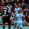 Photo - Manchester City's David Silva, top, celebrates his goal with his teammates during their English Premier League soccer match against Newcastle United at St James' Park, Newcastle, England, Sunday, Aug. 17, 2014. (AP Photo/Scott Heppell)