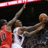 Photo - Atlanta Hawks guard Jeff Teague (0) shoots in front of Chicago Bulls guard Tony Snell (20) during the first half of an NBA basketball game Wednesday, April 2, 2014, in Atlanta. (AP Photo/Jason Getz)