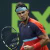 Photo - Spain's Rafael Nadal clenches his fist after winning a point against Germany's Peter Gojowczyk in their semifinal match the Qatar Open tennis tournament at the Khalifa Tennis Complex in Doha, Qatar, Friday, Jan. 3, 2014. (AP Photo/Osama Faisal)