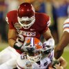 Oklahoma\'s Travis Lewis (28) takes down Florida\'s Tim Tebow (15) during the first half of the BCS National Championship college football game between the University of Oklahoma Sooners (OU) and the University of Florida Gators (UF) on Thursday, Jan. 8, 2009, at Dolphin Stadium in Miami Gardens, Fla. PHOTO BY CHRIS LANDSBERGER, THE OKLAHOMAN