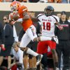 Oklahoma State\'s Justin Gilbert (4) breaks up a pass intended for Texas Tech\'s Eric Ward (18) during a college football game between Oklahoma State University (OSU) and Texas Tech University (TTU) at Boone Pickens Stadium in Stillwater, Okla., Saturday, Nov. 17, 2012. Photo by Bryan Terry, The Oklahoman
