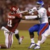 OU\'s R.J. Washington (11) tries to bring down KU\'s James Sims (29) during the college football game between the University of Oklahoma Sooners (OU) and the Kansas Jayhawks (KU) at Gaylord Family-Oklahoma Memorial Stadium in Norman, Okla., Saturday, Oct. 20, 2012. Photo by Bryan Terry, The Oklahoman