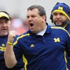 Photo - FILE - In this Nov. 24, 2012 file photo, Michigan head coach Brady Hoke yells at his team in an NCAA college football game against Ohio State in Columbus, Ohio. It has already been a successful season for No. 3 Ohio State, but as the Buckeyes know, no season is a success if they lose to their chief rivals, the Michigan Wolverines. (AP Photo/Jay LaPrete, File)