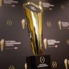 Photo - This Monday, July 14, 2014 photo shows the College Football Playoff National Championship Trophy in Irving, Texas. A rising gold football-shaped trophy will be the prize for the national champion in the new College Football Playoff. (AP Photo/Tony Gutierrez)