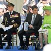 Britain\'s Prince Philip, French Prime Minister Manuel Valls and Britain\'s Queen Elizabeth II, from left, attend the Service of Remembrance, at the Commonwealth War Graves Commission Cemetery, in Bayeux, France Friday June 6, 2014, as part of the commemorations for the 70th anniversary of the D-Day landings. (AP Photo/Remy de la Mauviniere/Pool)