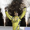 Photo - Kyle Busch celebrates in Victory Circle after winning the NASCAR Trucks auto race at Kentucky Speedway in Sparta, Ky., Thursday June 26, 2014.  (AP Photo/Garry Jones)