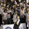 Texas Tech head coach Kliff Kingsbury, bottom center, raises the trophy in front of his team after Texas Tech beat Arizona State in the Holiday Bowl NCAA college football game Monday, Dec. 30, 2013, in San Diego. (AP Photo/Gregory Bull)