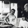 Photo - In this early 1950s photo, Hussien Karoub, right, talks with his son Muhammad Karoub at his Karoub Printing business in Highland Park, Mich. (AP Photo/Karoub Family)