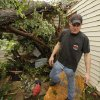 Bryan Stout walks past the tree that temporarily blocked his family\'s exit from the storm shelter where they rode out a tornado-spawning storm on Tuesday, May 24, 2011, in Newcastle, Okla. Photo by Steve Sisney, The Oklahoman