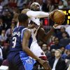 Photo - Miami Heat's LeBron James (6) works against Dallas Mavericks' Rodrigue Beaubois (3) during the first half of an NBA basketball game in Miami, Wednesday, Jan. 2, 2013. (AP Photo/J Pat Carter)
