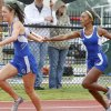 Stillwater\'s Tristen Smith hands the baton off to teammate Rachel Meier in the girls 4 x 100 relay during the 5A and 6A state finals track meet at Yukon High School in Yukon, OK, Friday, May 11, 2012, By Paul Hellstern, The Oklahoman