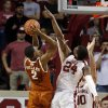 Oklahoma Sooner Buddy Hield (24) tries to block a shot by Demarcus Holland in the second half as the University of Oklahoma Sooners (OU) men defeat the Texas Longhorns (TU) 77-65 in NCAA, college basketball at The Lloyd Noble Center on Saturday, March 1, 2014 in Norman, Okla. Photo by Steve Sisney, The Oklahoman