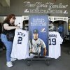 Photo - Elaine Rosenkranz, from Galloway, New Jersey, looks at a Derek Jeter jersey after watching a New York Yankees spring training baseball practice Tuesday, Feb. 18, 2014, in Tampa, Fla. (AP Photo/Charlie Neibergall)