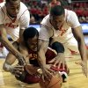 Photo - Texas Tech's Jaye Crockett and Toddrick Gotcher battle for the ball with Iowa State's Tyrus McGee, bottom, during their NCAA college basketball game, Wednesday, Jan. 23, 2013, in Lubbock, Texas. (AP Photo/The Avalanche-Journal, Stephen Spillman) ALL LOCAL TV OUT
