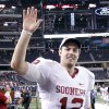 Oklahoma\'s Landry Jones (12) waves to fans as he runs off the field after the Sooners\' 23-20 win over Nebraska during the Big 12 football championship game between the University of Oklahoma Sooners (OU) and the University of Nebraska Cornhuskers (NU) at Cowboys Stadium on Saturday, Dec. 4, 2010, in Arlington, Texas. Photo by Chris Landsberger, The Oklahoman