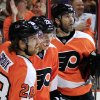 Photo -   From left, Philadelphia Flyers' Claude Giroux, Erik Gustafsson and Jaromir Jagr look up at the replay of Gustafsson's goal during the second period in Game 6 of an NHL hockey Stanley Cup first-round playoff series against the Pittsburgh Penguins, Sunday, April 22, 2012, in Philadelphia. The Flyers won 5-1 and won the series to advance. (AP Photo/Tom Mihalek)