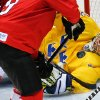 Photo - Goalkeeper Valentina Wallner of Sweden (35) blocks a shot on the goal during the second period of the of the women's bronze medal ice hockey game against Switzerland at the 2014 Winter Olympics, Thursday, Feb. 20, 2014, in Sochi, Russia. (AP Photo/Petr David Josek)
