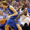 Oklahoma City\'s Kendrick Perkins (5) knocks the ball away from Dallas\' Dirk Nowitzki (41) in the fourth quarter during game one of the first round in the NBA playoffs between the Oklahoma City Thunder and the Dallas Mavericks at Chesapeake Energy Arena in Oklahoma City, Saturday, April 28, 2012. Oklahoma City won, 99-98. Photo by Nate Billings, The Oklahoman