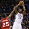 Oklahoma City Thunder forward Kevin Durant (35) shoots over Philadelphia 76ers guard Elliot Williams during the third quarter of an NBA basketball game in Oklahoma City, Tuesday, March 4, 2014. Oklahoma City won 125-92. (AP Photo/Sue Ogrocki)