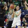 Photo - Notre Dame forward Natalie Achonwa, center, tries to control the ball against Oklahoma State guard Tiffany Bias, left, and forward Katelyn Loecker during the first half of a regional semifinal in the NCAA college basketball tournament at the Purcell Pavilion in South Bend, Ind., Saturday, March 29, 2014. Notre Dame won 89-72. (AP Photo/Nam Y. Huh)