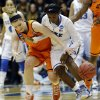 Duke\'s Alexis Jones, right, and Oklahoma State\'s Liz Donohoe chase a loose ball during the first half of a second-round game in the women\'s NCAA college basketball tournament in Durham, N.C., Tuesday, March 26, 2013. (AP Photo/Gerry Broome)