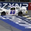 Photo - Austin Theriault crosses the finish line to win the ARCA Corrigan Oil 200 auto race at Michigan International Speedway in Brooklyn, Mich., Friday, June 13, 2014. (AP Photo/Carlos Osorio)