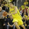 Michigan forward Mitch McGary (4) looks up court during the first half of an NCAA college basketball game against Arizona in Ann Arbor, Mich., Saturday, Dec. 14, 2013. (AP Photo/Carlos Osorio)