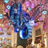 Photo - This January 2013 photo provided by The Venetian in Las Vegas shows a Chinese New Year art installation welcoming the year of the snake in the waterfall atrium connecting The Venetian and The Palazzo resorts. The display features an animatronic snake coiled in a tree decorated with flowers, lanterns and coins. Las Vegas celebrates Chinese New Year in a big way with feasts, exhibits, performances and other events around the city. The year of the snake begins Feb. 10. (AP Photo/The Venetian, Audrey Dempsey)