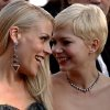 Busy Philipps, left, and Michelle Williams arrive before the 84th Academy Awards on Sunday, Feb. 26, 2012, in the Hollywood section of Los Angeles. (AP Photo/Joel Ryan) ORG XMIT: OSC330