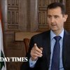 Photo - In this image taken from video filmed on Thursday, Feb. 28, 2013 and released Saturday evening, March 2, 2013, Syrian President Bashar Assad gestures while speaking during an interview with the Sunday Times, in Damascus, Syria. Iran and Syria condemned a U.S. plan to assist rebels fighting to topple Assad on Saturday and signaled the Syrian leader intends to stay in power at least until 2014 presidential elections. Assad told the Sunday Times in the interview timed to coincide with U.S. Secretary of State John Kerry's first foreign trip that