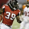 Photo - Atlanta Falcons running back Steven Jackson (39) moves the ball against the Cincinnati Bengals during the first half of a preseason NFL football game, Thursday, Aug. 8, 2013, in Atlanta.  (AP Photo/David Goldman)