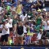 Photo - Oregon fans cheer of the Women's College World Series softball tournament  game between Oregon and Alabama at ASA Hall of Fame Stadium in Oklahoma City, Sunday, June 1, 2014. Photo by Sarah Phipps, The Oklahoman