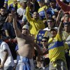 Photo -   Boca Juniors' fans cheer before the game against Argentinos Juniors during an Argentina's league soccer match in Buenos Aires, Argentina, Sunday, Sept. 9, 2012. (AP Photo/Eduardo Di Baia)