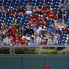 Photo - Philadelphia Phillies left fielder Domonic Brown walks back to his position after misplaying run-scoring double by Miami Marlins' Marcell Ozuna during the fourth inning of a baseball game, Wednesday, June 25, 2014, in Philadelphia. Miami won 3-2. (AP Photo/Matt Slocum)