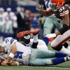 Dallas Cowboys\' Tony Romo (9) momentarily loses control of the ball after being brought down by Cleveland Browns\' Trevin Wade, center back, and Jabaal Sheard (97) in the second half of an NFL football game on Sunday, Nov. 18, 2012, in Arlington, Texas. Romo recovered the ball. (AP Photo/Sharon Ellman)