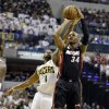Miami Heat\'s Ray Allen (34) puts up a shot against Indiana Pacers\' Sam Young (4) during the first half of Game 3 of the NBA Eastern Conference basketball finals in Indianapolis, Sunday, May 26, 2013. (AP Photo/Nam H. Huh)
