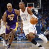 GAME THREE / L.A. LAKERS: Oklahoma City\'s Kevin Durant (35) dribbles past Ron Artest (37) of L.A. during the NBA basketball game between the Los Angeles Lakers and the Oklahoma City Thunder in the first round of the NBA playoffs at the Ford Center in Oklahoma City, Thursday, April 22, 2010. Photo by Nate Billings, The Oklahoman ORG XMIT: KOD