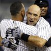 New York Yankees\' Alex Rodriguez, left, embraces Raul Ibanez after Ibanez hit a 12th inning, walk-off RBI single to give the Yankees a 4-3 win in their baseball game against the Boston Red Sox at Yankee Stadium in New York, Tuesday, Oct. 2, 2012. (AP Photo/Kathy Willens)
