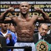 FILE - In this May 4, 2012 file photo, Floyd Mayweather Jr. flexes during his weigh-in for his super welterweight title fight against Miguel Cotto in Las Vegas. Mayweather Jr. finally confirms he\'ll fight Robert Guerrero on May 4, but the biggest star in boxing says he\'ll continue his career on a different network. After several years on HBO, Mayweather has signed a multifight deal with Showtime. (AP Photo/Julie Jacobson, File)