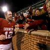 Photo - BEDLAM FOOTBALL / CELEBRATION: Oklahoma's Landry Jones (12) celebrates with fans after the Bedlam college football game between the University of Oklahoma Sooners (OU) and the Oklahoma State University Cowboys (OSU) at Gaylord Family-Oklahoma Memorial Stadium in Norman, Okla., Saturday, Nov. 24, 2012. Oklahoma won 51-48. Photo by Bryan Terry, The Oklahoman