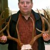 Robert Fleenor, chief law enforcement at the Oklahoma Department of Wildlife Conservation, poses with antlers from the \'BP Buck\' at the Department of Wildlife Conservation offices in Oklahoma City on Wednesday, March 30, 2011. The BP Buck was killed by a Bokoshe man who pleaded guilty last week and had his hunting license revoked for 20 years. State wildlife officials plan to use the rack in an educational display. Photo by John Clanton, The Oklahoman