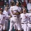 Oklahoma\'s Tyler Ogle (35) reacts with teammate Danny Black (9) after Ogle\'s game winning score during the bottom of the ninth inning in the Sooners\' 3-2 win in the fourth game of the Big 12 Baseball Championship between Oklahoma and Kansas at the Bricktown Ballpark on Wednesday, May 26, 2010, in Oklahoma City, Okla. Photo by Chris Landsberger, The Oklahoman