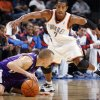Photo - Oklahoma City's Kevin Ollie (7) chases Sergio Rodriguez (10) of Sacramento as Rodriguez tries to keep control of the ball during the preseason NBA basketball game between the Sacramento Kings and the Oklahoma City Thunder at the Ford Center in Oklahoma City, Thursday, Oct. 22, 2009. Sacramento won, 104-89. Photo by Nate Billings, The Oklahoman ORG XMIT: KOD