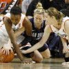 Oklahoma State\'s Toni Young, left, and Liz Donohoe fight for the loose ball with San Diego\'s Izzy Chilcott during the women\'s NIT semifinal college basketball game between Oklahoma State University (OSU) and San Diego at Gallagher-Iba Arena in Stillwater, Okla., Wednesday, March 28, 2012. Photo by Bryan Terry, The Oklahoman