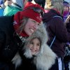 Photo - Aliy Zirkle poses for the photo with 8-year-old Autumn Nanouk. Zirkle is the first musher to reach the Bering Sea in Unalakleet during the 2014 Iditarod Trail Sled Dog Race on Saturday, March 8, 2014. Autumn's grandmother, Rhoda Nanouk, made Nanouk's wolf ruff parka. (AP Photo/The Anchorage Daily News, Bob Hallinen)