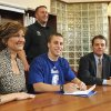 Norman North football player Scott Whitaker, surrounded by parents David and Kim, signs a letter of intent to play college football at Drake on Wednesday, Feb 3, 2010, in Norman, Okla. Norman North head coach Lance Manning is in the background. Photo by Steve Sisney, The Oklahoman