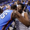 Oklahoma City\'s Kevin Durant (35) hugs his mother Wanda Pratt after winning Game 4 of the first round in the NBA playoffs between the Oklahoma City Thunder and the Dallas Mavericks at American Airlines Center in Dallas, Saturday, May 5, 2012. Oklahoma City won 103-97. Photo by Bryan Terry, The Oklahoman