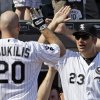 Photo - Kevin Youkilis, left, celebrates with manager Robin Ventura after hitting a two-run home run during the fifth inning of a July 7 game against the Blue Jays. Youkilis had some issues with former Red Sox manager Terry Francona during his time in Boston but speaks highly of Ventura. AP photo