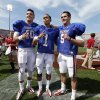 OU / UNIVERSITY OF OKLAHOMA / COLLEGE FOOTBALL: Quarterbacks Blake Bell (10), Kendal Thompson (1) and Trevor Knight (9) pose for a fan photograph after the annual Spring Football Game at Gaylord Family-Oklahoma Memorial Stadium in Norman, Okla., on Saturday, April 13, 2013. Photo by Steve Sisney, The Oklahoman