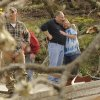 Jim and Jennie Hood embrace after a tornado hit and completely tore down their home on Short Tail Springs Rd. Friday, March 2, 2012 in Harrison, Tenn. Powerful storms stretching from the Gulf Coast to the Great Lakes flattened buildings in several states, wrecked two Indiana towns and bred anxiety across a wide swath of the country in the second powerful tornado outbreak this week. (AP Photo/Chattanooga Times Free Press, Ashlee Culverhouse) ORG XMIT: TNCHA117